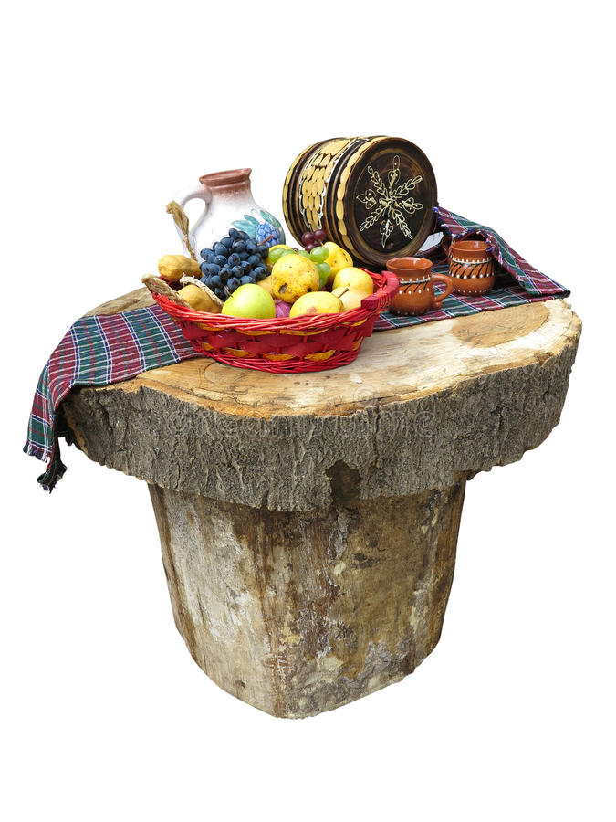 Table made of logs with fruit basket and wine barrel. Table made of logs with fruit basket and small wine barrel stock images