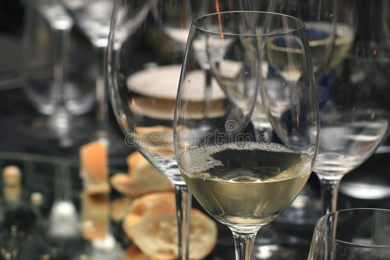 Table with many glasses of white wine. Table with many white wine glasses to celebrate stock photo