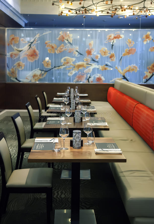 Table in modern restaurant. Glasses on table in modern restaurant royalty free stock images