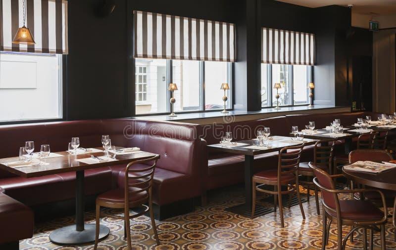 Table in modern restaurant. Glasses on table in modern restaurant stock image