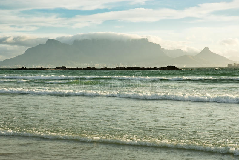 Table Mountain and waves royalty free stock photo
