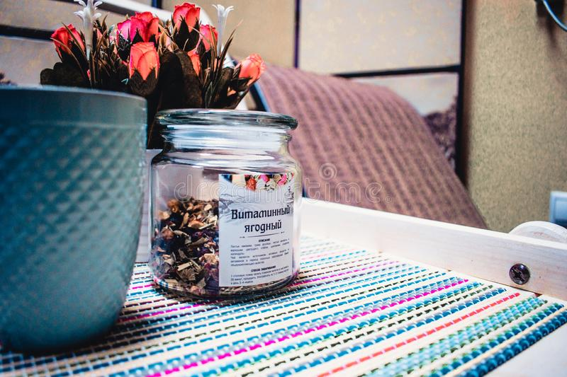 Flowers on the background of tea and lounge chairs stock photography