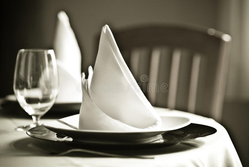 Table and napkins. A restaurant decorated table ready to eat with napkins stock images