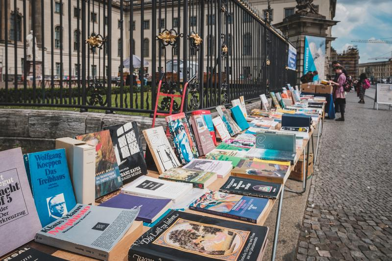 Table with old books, second hand book store on flea market in front of the Humboldt University in Berlin stock images