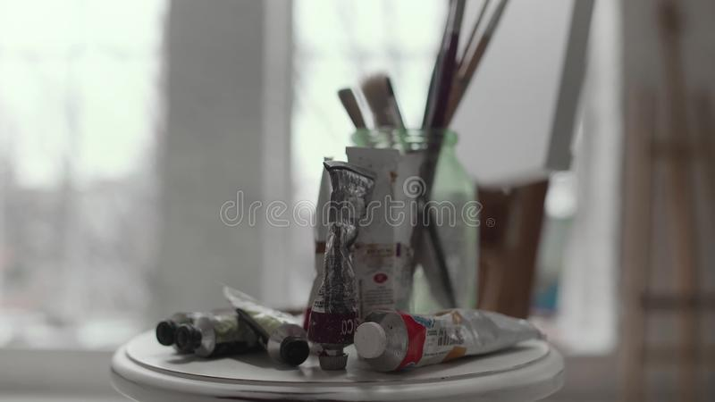 Table with paints and brushes close up stock video