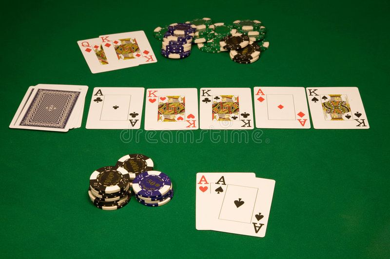 Table poker in casino. Win on hi-stakes table in casino on green background royalty free stock photography