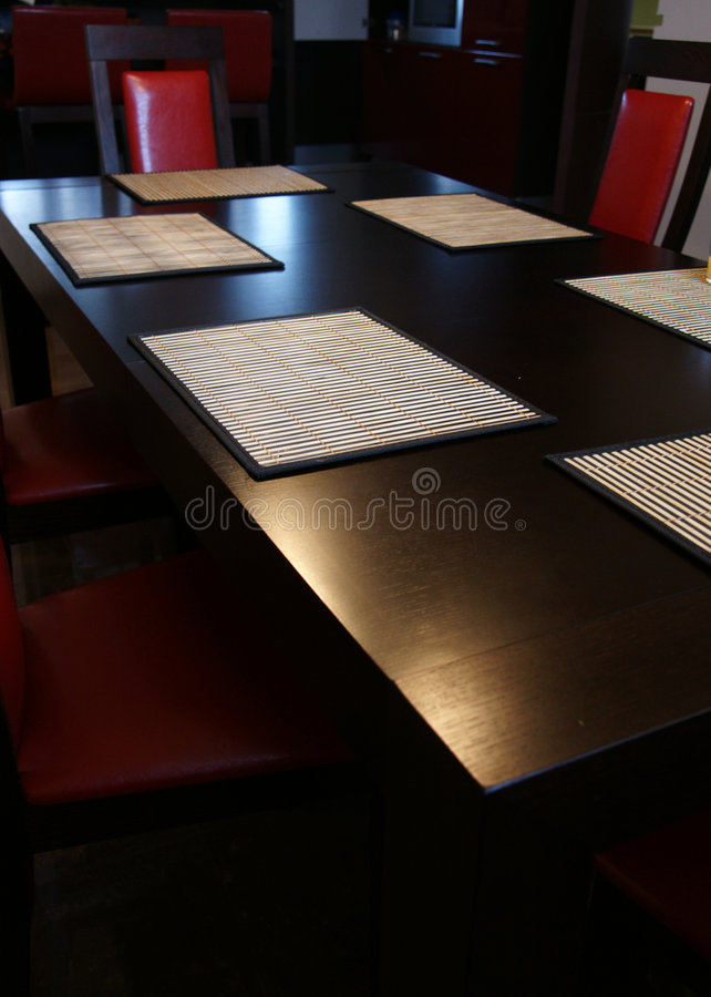 Table with Red Chairs stock images