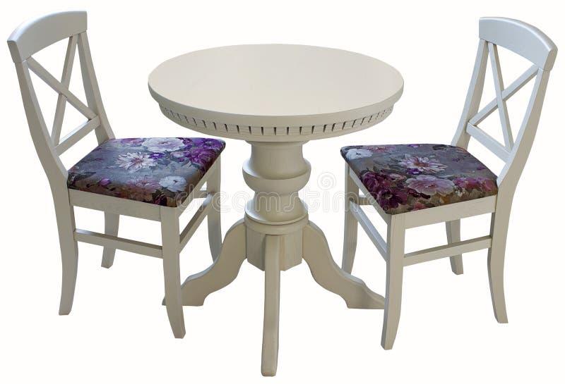 Table ronde en bois blanche avec deux chaises image stock