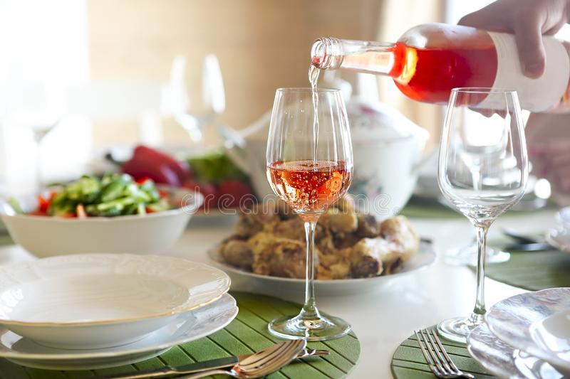 Table with rose wine, fish soup, salad and chiken royalty free stock photos