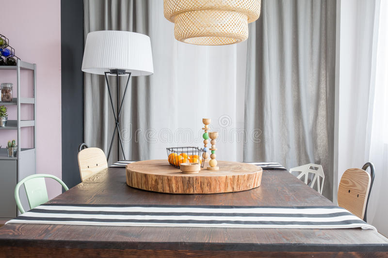 Table and round wood slab. Room with table, round wood slab and ceiling lamp stock photos