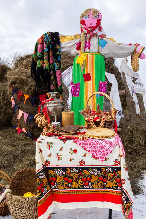 Table with Russian folk desserts and a samovar stock photos