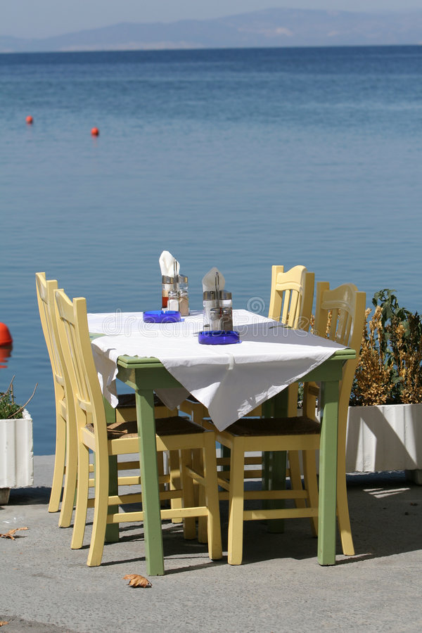 Table by the sea stock photography