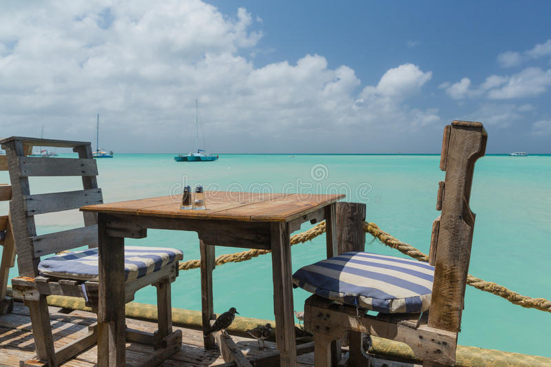 Table with a Sea View in Aruba royalty free stock image