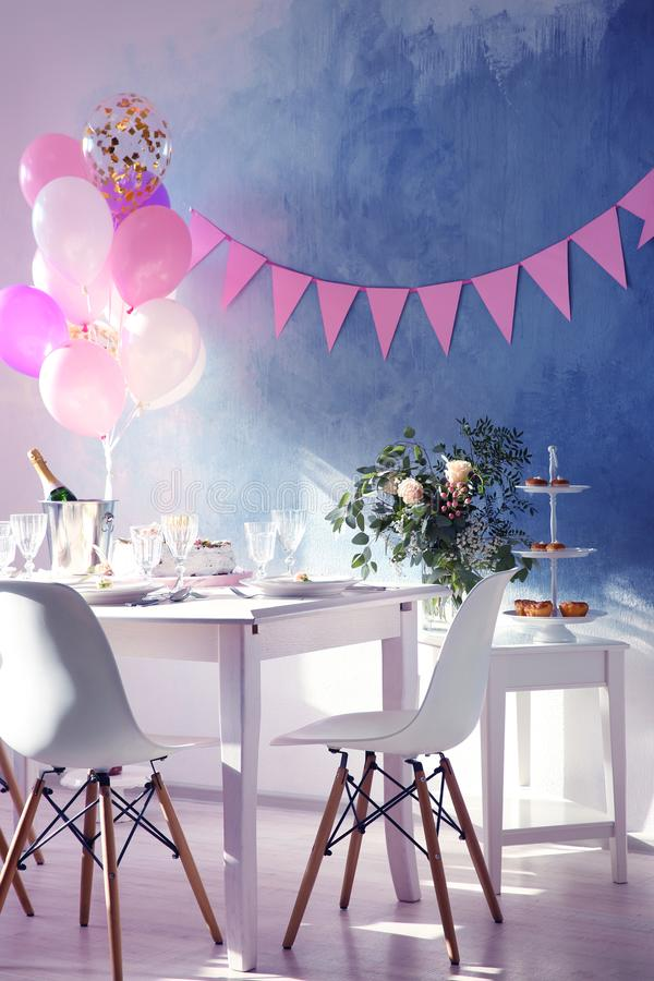 Table served for Birthday dinner. In living room royalty free stock photo
