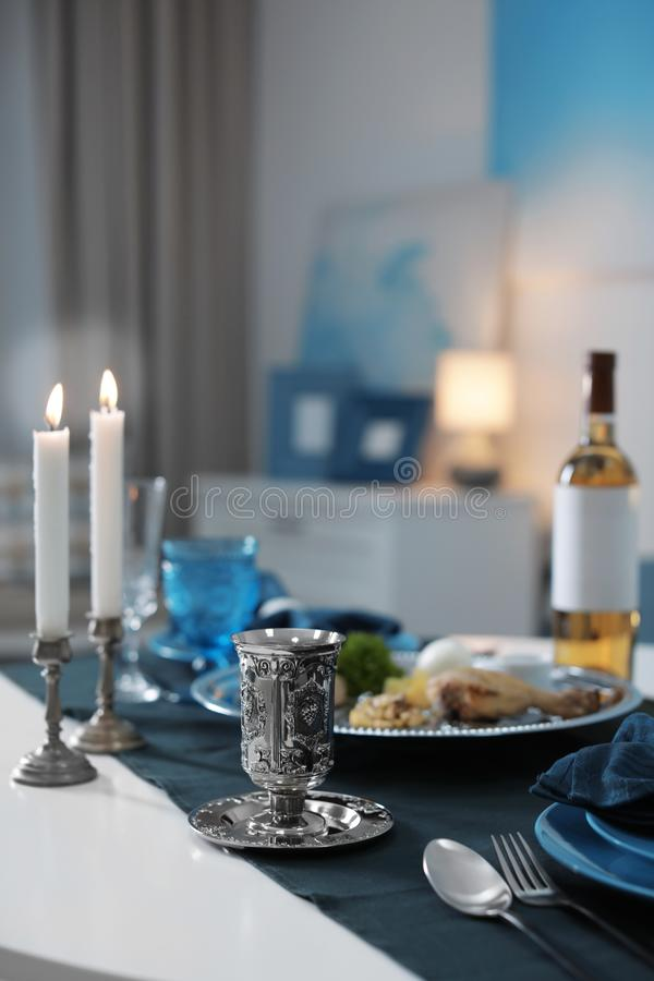Table served for Passover Pesach Seder indoors. Space for text stock image