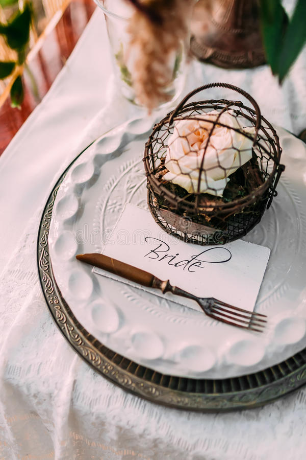 Table served in rustic style for wedding dinner. Bridal table outdoor. Cutlery. Close-up, top view stock images
