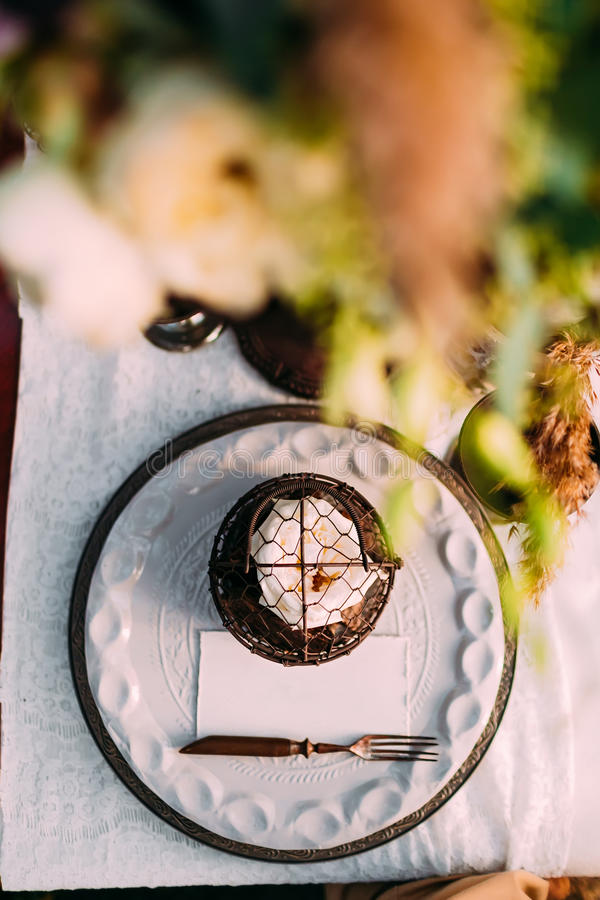 Table served in rustic style for wedding dinner. Bridal table outdoor. Cutlery. Close-up, top view royalty free stock image
