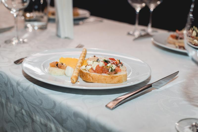 Table served for a wine tasting. Snacks with Pasta, Cheese, Vegetables. Spain tapas recipe food pintxos. Served dish for. Food and wine tasting royalty free stock photos