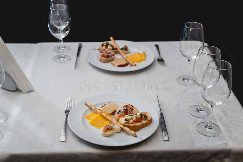 Table served for a wine tasting. Snacks with Pasta, Cheese, Vegetables. Spain tapas recipe food pintxos. Served dish for. Food and wine tasting royalty free stock image
