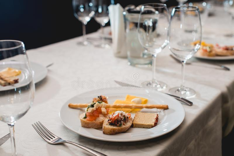 Table served for a wine tasting. Snacks with Pasta, Cheese, Vegetables. Spain tapas recipe food pintxos. Served dish for. Food and wine tasting stock photo