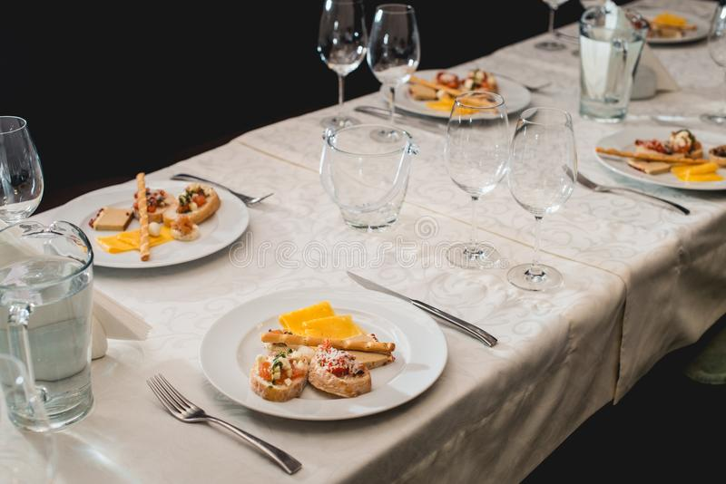 Table served for a wine tasting. Snacks with Pasta, Cheese, Vegetables. Spain tapas recipe food pintxos. Served dish for. Food and wine tasting royalty free stock photo