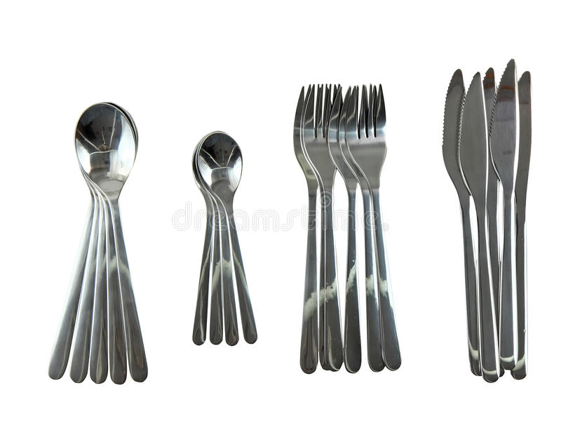 Table serving-kniven, skeden, gaffel på den vita bakgrunden. arkivbild