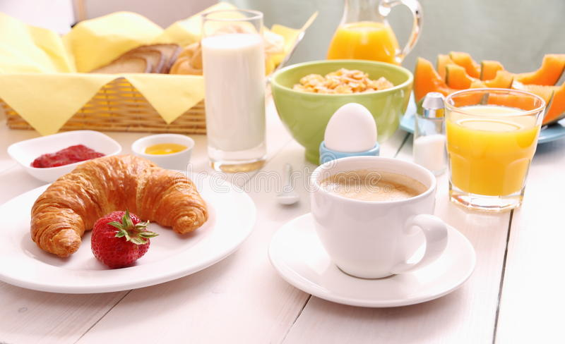 Table set for breakfast with healthy food. Horizontal royalty free stock image