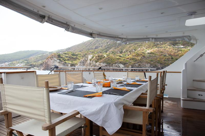 Table Set For Breakfast On The Rear Deck Of A Luxury ...