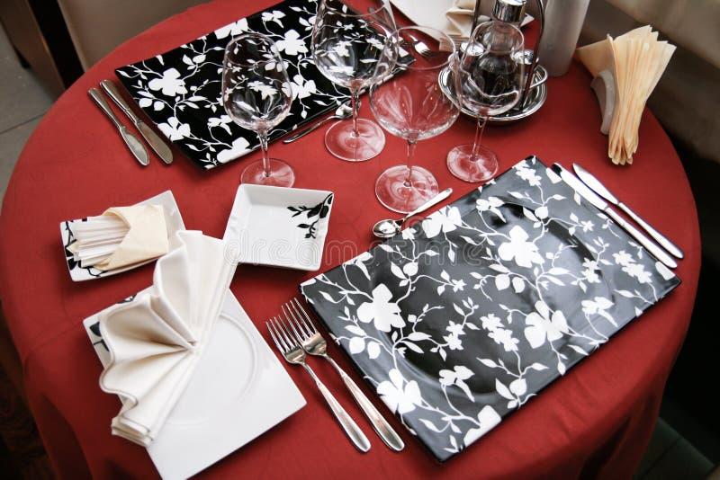 Table set for dinner in modern restaurant. Table set in a modern restaurant royalty free stock photography