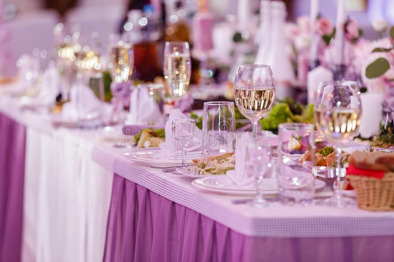 Table set for an event party or wedding reception. Wedding table setting. wine glasses stock photo