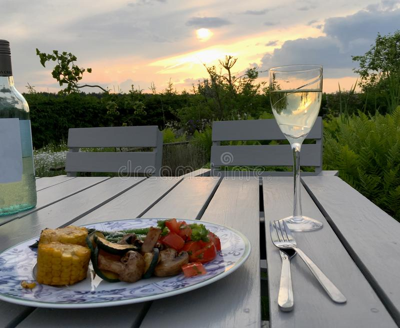 Dinner outside in the garden royalty free stock images