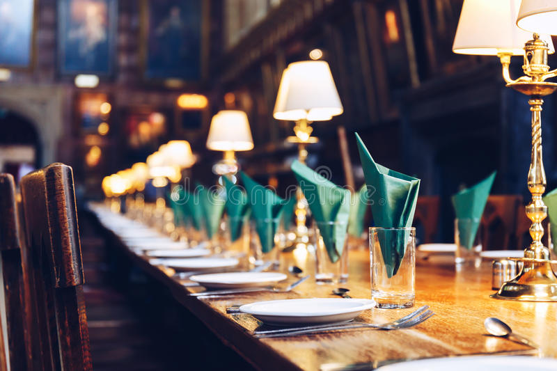 Table set at The Great Hall of Christ Church, University of Oxford. The Hall was replicated at film studios as the grand dining hall at Harry Potter`s Hogwarts stock image