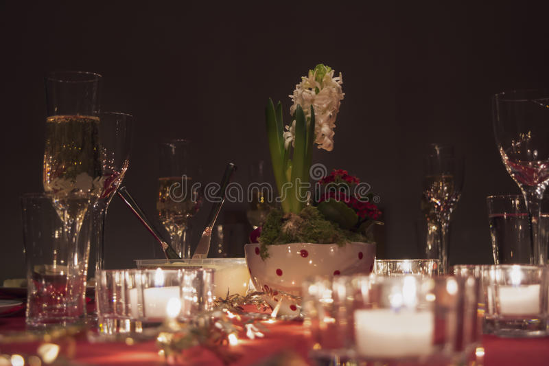 Table set for party with champagne. Table set for a luxurious dinner, with candles and champagne glasses royalty free stock photo