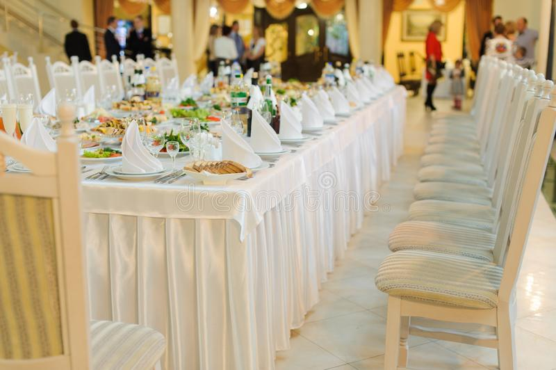 Table set service with silverware and glass stemware at restaurant before party. Appetizer, arrangement, cheese, cup, drink, energy, food, dinner, formal royalty free stock photos