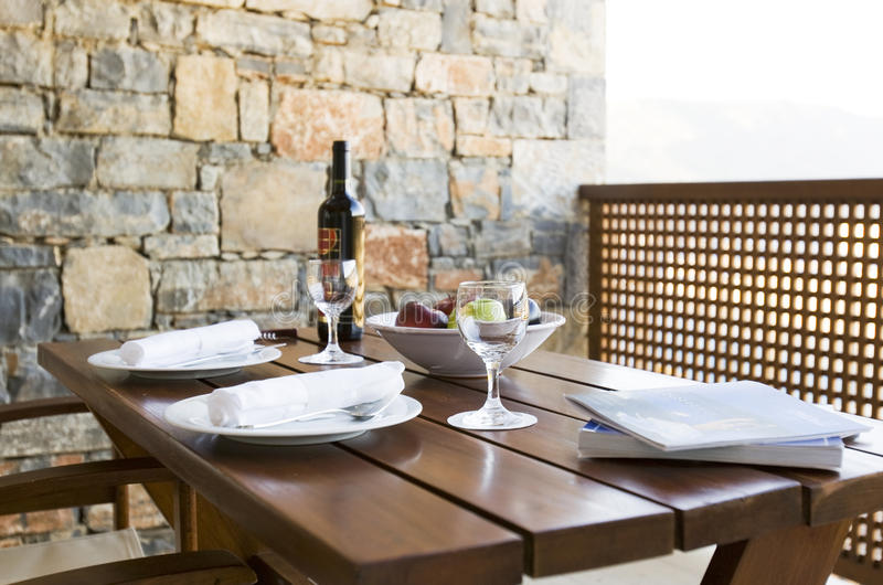 Table set on the terrace. In summer royalty free stock photography