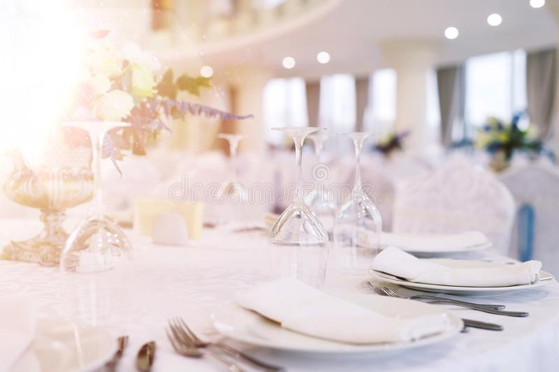Table set for wedding or another catered event dinner.  royalty free stock image