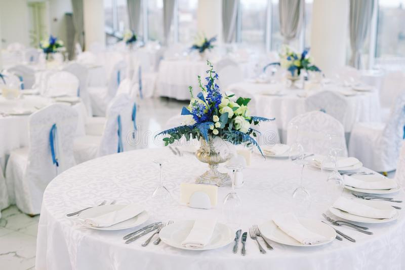 Table set for wedding or another catered event dinner.  stock photo
