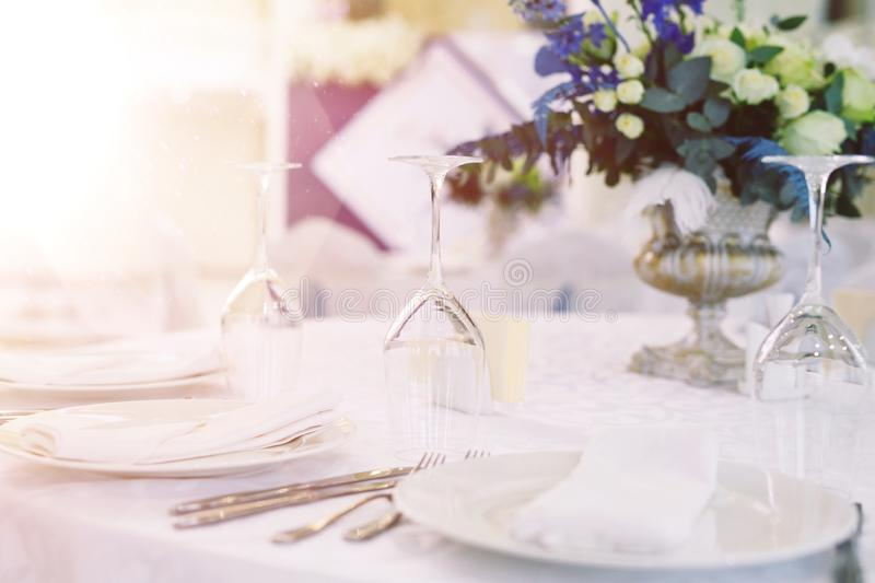 Table set for wedding or another catered event dinner.  stock image