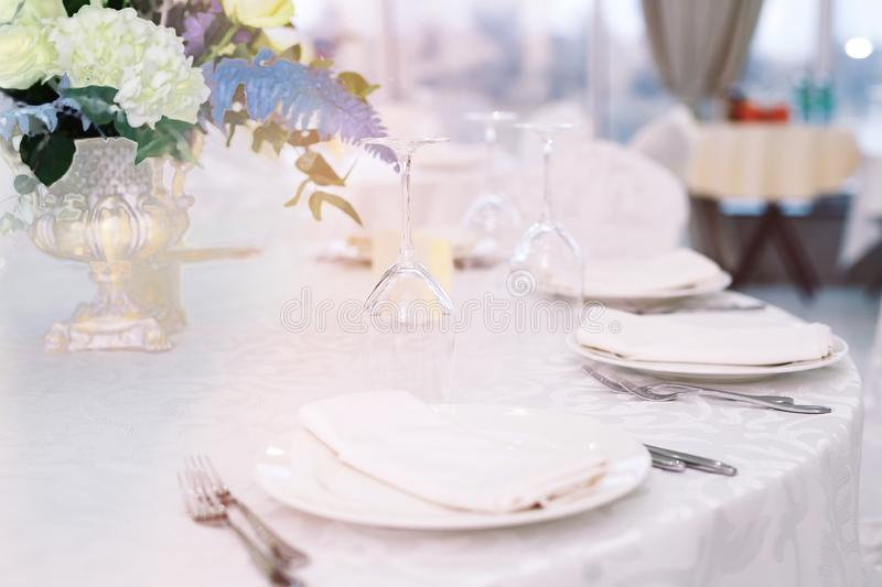 Table set for wedding or another catered event dinner.  royalty free stock images