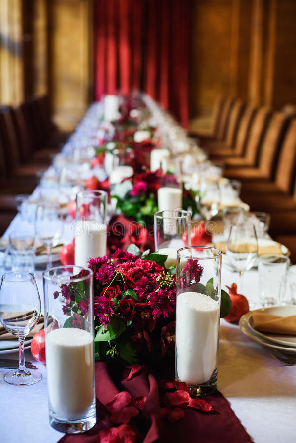 Table set for wedding or another catered event dinner. Beautiful table set for wedding or another catered event dinner royalty free stock photography