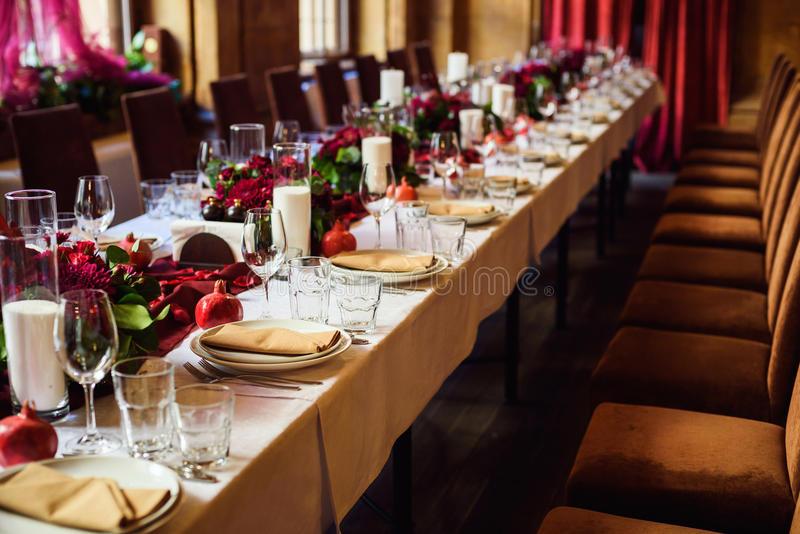 Table set for wedding or another catered event dinner. Beautiful table set for wedding or another catered event dinner royalty free stock photo
