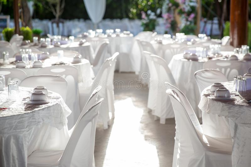 Table set for wedding or another catered event dinner, luxury wedding table setting for fine dining. At outdoors stock image