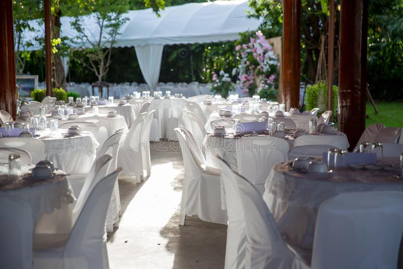 Table set for wedding or another catered event dinner. Luxury wedding table setting for fine dining at outdoors royalty free stock image