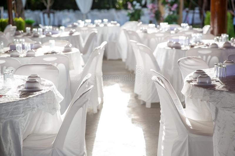 Table set for wedding or another catered event dinner. Luxury wedding table setting for fine dining at outdoors stock images