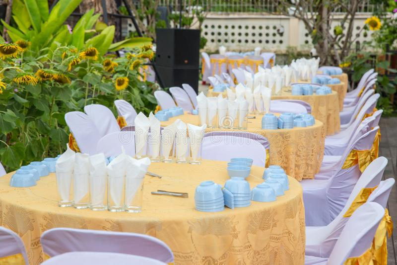 Table set for wedding or another catered event dinner, luxury wedding table. Setting for fine dining at outdoors royalty free stock images