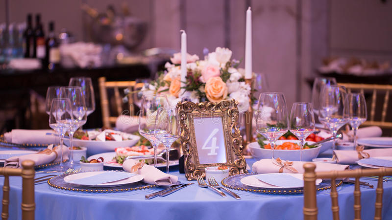 Table set for wedding or another catered event dinner. Number four royalty free stock images