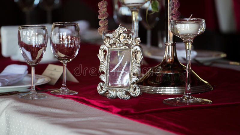Table set for wedding or another catered event dinner. Number four royalty free stock photography