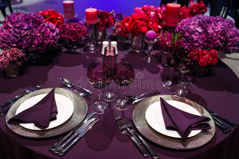 Table set for wedding or another catered event dinner.  stock images