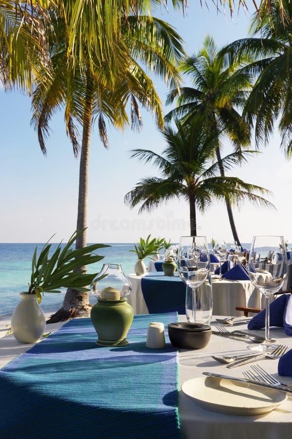 Table setting at beach restaurant stock photos