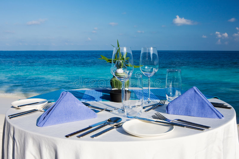 Table setting at beach restaurant royalty free stock photography